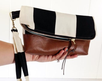Fold over Black and White Clutch with Faux Leather bottom and gold hardware