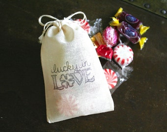 Wedding favor bags, muslin, 3x4.5.  Set of 50 hand stamped cotton bags. Lucky in Love design with four leaf clover.