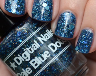 Pale Blue Dots, a navy jelly loaded with blue circle glitters and gold holographic microglitter, inspired by Carl Sagan, by Digital Nails