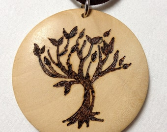 Pyrography tree Amity inspired by the peaceful Divergent series
