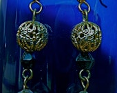 80s style black polka dot and gold dangles with filagree brass bead earrings