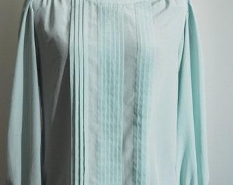 Sea foam or mint green, pleated secretary blouse. Size M to L.