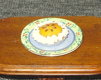 Dollhouse miniature pie on a serving plate