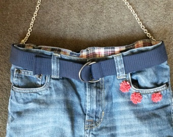 Handbag made of jeans with lining and decorated with red flowers