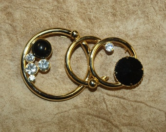 Vintage black clear crystal circle brooch pin