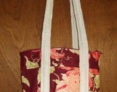 Small fabric zippered purse, fully lined.