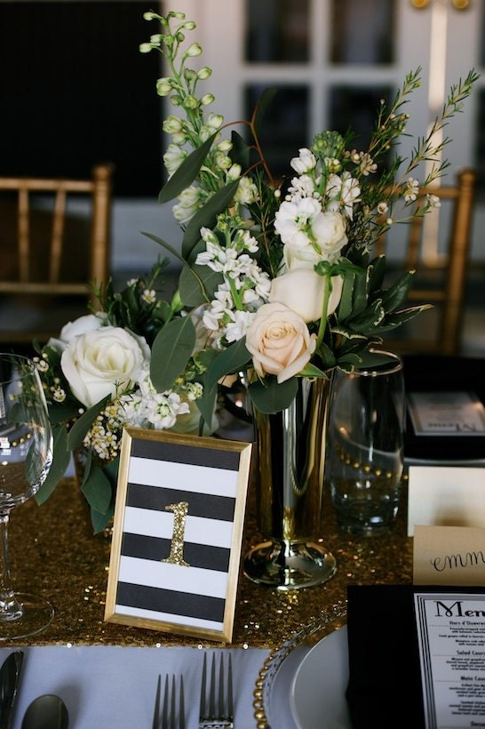 Black gold framed table numbers hollywood glam