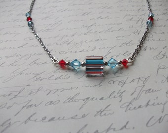 Turquoise and red crystal necklace with lined cane glass bead