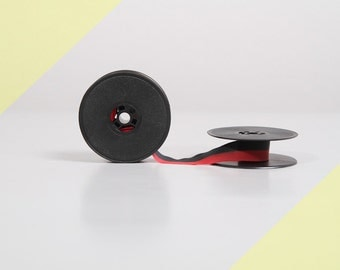 Typewriter ribbon for Olivetti typewriters. Black & red. Nylon. Double spools 51 mm. 13 mm wide.