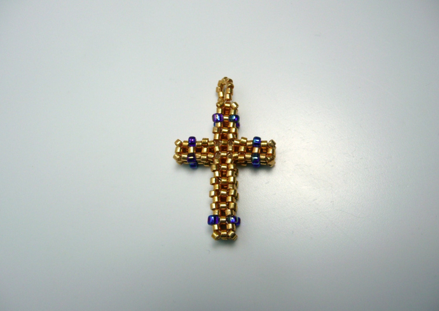 blue and gold beaded cross pendant cross by