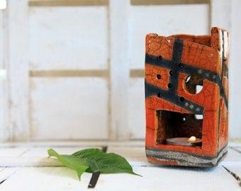 orange candle holder raku pottery geometric