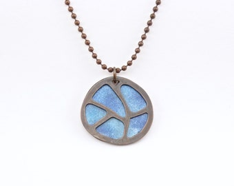Handmade reversible enameled pendant; copper silhouette with reversible enameled background of blue or melon.