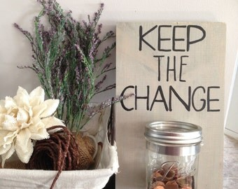 Keep The Change. A loose change container. Available in different color schemes and font.