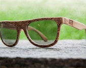 Handcrafted wooden glasses with laser engraved texture, Made in Italy.