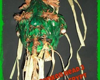 """Schrumpfkopf """"Loco"""" Shrunken Head Zombie Green"""