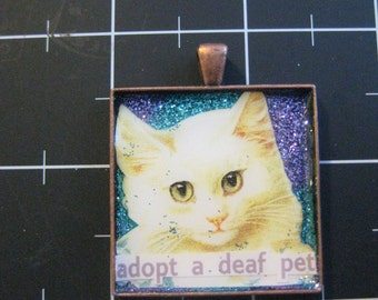 White Cat Pendant, Adopt a Deaf Pet, Double blue swirled glitter background, 50% goes to the current selected animal charity