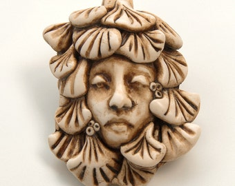 Faux-Ivory Handmade Pendant-  Face Surrounded by Leaves