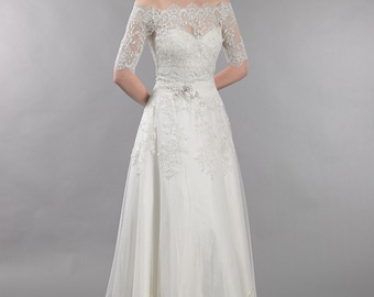 Ivory strapless lace wedding dress with off shoulder bolero