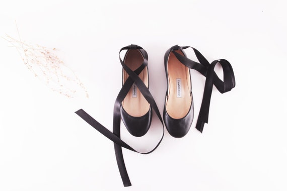 black leather ballet flats with ankle ribbons by