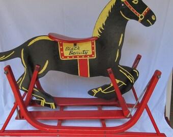 Vintage  wooden black beauty rocking or sliding horse