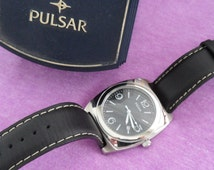 Pulsar Watch in Original Box - Clean Crystal - Clean Band - Clean Box - Like New Condition - Leather Band - Silver Tone Metal - Unisex