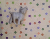 tiny bisque ceramic dog