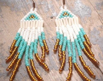 native american navajo style seed bead chandelier earrings of off white, turquoise and copper brown. hand woven by val b.