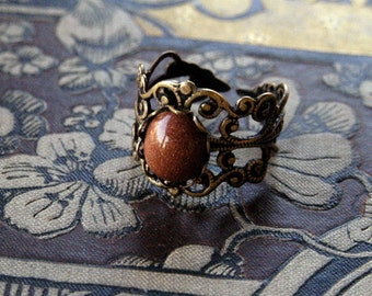 Goldstone and Brass Filigree Ring