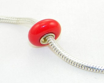 Opaque red glass bead with sterling silver core for European charm bracelets and necklaces
