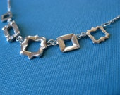 Five Tiny Frames Necklace.  Sterling Silver.