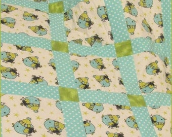 Blue Bird baby crib quilt / blanket in Shades of Olive and Teal Green Flannel-Cotton vintage typewriter keys and polka-dots