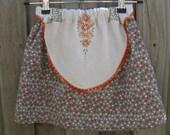 Doily apron skirt orange and green spots