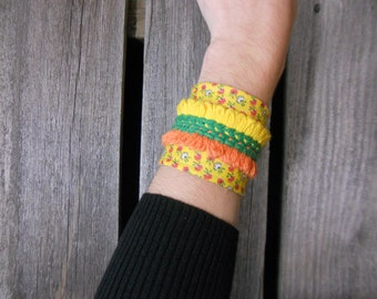 Eccentric cuff bracelet/ arm band/ made from vintage reclaimed materials/ bright colors, yellow, orange, green/ Eco wear/ geometric/ stripes