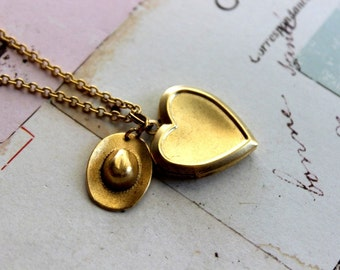cowgirl hat. heart locket necklace. gold ox