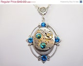 ON SALE Steampunk Finery Necklace With Vintage Watch Movement And Deep Blue Sea Crystals