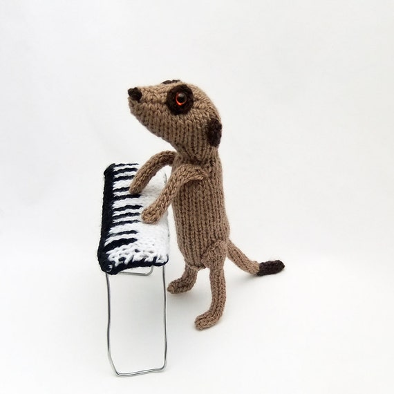 Meerkat pianist, piano player, knitted meerkat playing a knitted piano, knitted keyboard, musician, musical, music, meercat