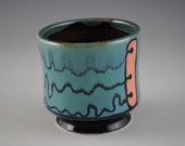 Hand Made Porcelain Cup With Playful Design
