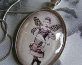 Captured fairy - little fairy rascal - domed glass pendant, original collage under glass, sterling silver.