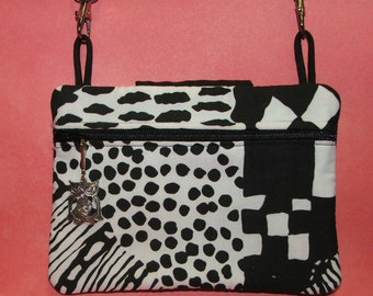 One of a Kind.....Hipster bag w/backside phone pocket with snap closure...the perfect Grab n Go Bag...