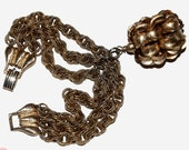 Signed Napier triple strand gold tone bracelet with large acorn focal charm shipping included to U.S.A and Canada