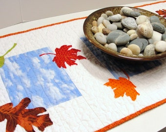 """Autumn quilted table runner with blue sky and falling leaves """"Splendor""""  READY TO SHIP"""