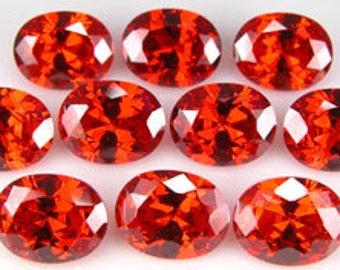Super fiery ORANGE CZs ~ 9x7mm Oval ~  item# ORCZ4 ~ Cubic Zirconia ~ FDK