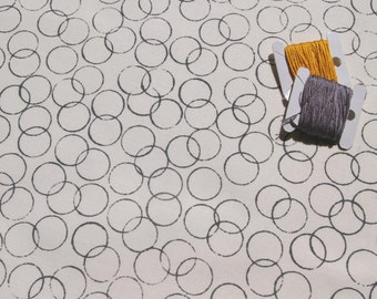 circles - stone hand screen printed onto natural linen / white cotton