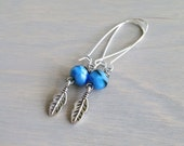 Mila.  Silver and blue bead, silver feather earrings