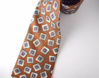 ATOMIC COURCHEVEL DAMON necktie mod, rockabilly style, tumbling squares with variegated backdrop, warm brown backdrop