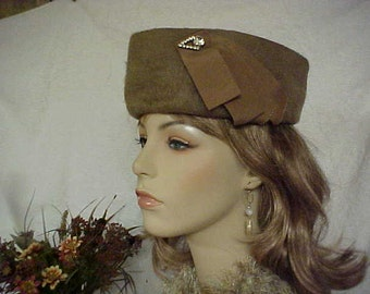 Taupe pill box hat with triangle crown and side rhinestone adornment- fits 22 - 22 1/2 inches