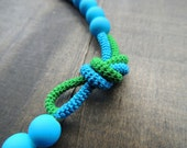Matte deep sky blue glass beads pimped with a double knotted crochet tube