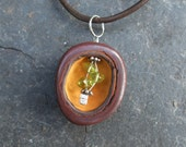 Pod necklace - Iron Stone cave / womb holding Peridot handmade by NaturesArtMelbourne