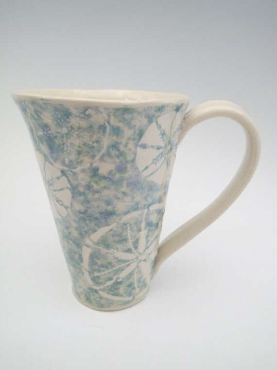 Handmade ceramic coffee mug with sand dollar design for Handmade mug designs