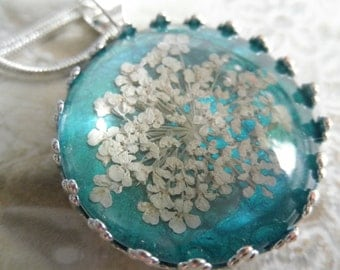 Queen Anne's Lace Beneath Glass Pendant Atop Ocean Green Blue Background Pressed Flower Pendant-Symbolizes Peace-Gifts Under 25-Nature's Art